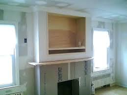 tv over fireplace simple design decor hide over fireplace home