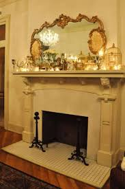 Decorating A Fireplace Mantle With Ornate Mirror And Candles And  Accessories : Home Designs And Decor