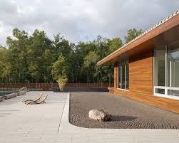 minimalism is the main characteristic you should consider designing a zen garden a single rock