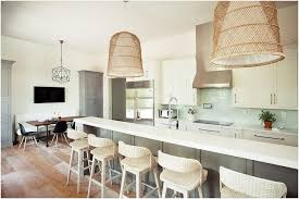 lighting for kitchen island two oversized woven basket chandeliers hang over a long gray kitchen