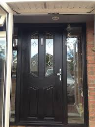 furniture single glass front door mixed by black wood and stainless handle also glass windows