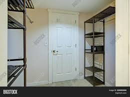 empty walk in closet. Simple Closet Empty Walk In Closet Features Clothes Racks And Metal Shelving Units To