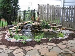 Lawn & Garden:Freshen Bakyard Small Fish Pond Ideas With Stone Waterfall  Also Black Iron