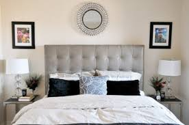 View in gallery Modern bedroom sporting tufted headboard in neutral colors