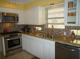 yellow and white painted kitchen cabinets. Perfect Shades Of Yellow Paint Colors Wall Kitchen Design Featuring L Shaped White Painted Wooden Cabinets With And E