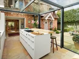 Cottage Design Ideas glass box extension on thatched cottage