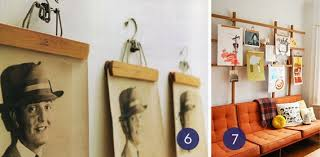 Hang art using vintage clothing hangers.
