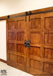 gorgeous rustic doors with hammered flat track sliding hardware enclose the art supplies in this homeowners