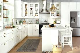 taking doors off kitchen cabinets a large off white kitchen with a large island gold fixtures and a dining area glass door kitchen cabinets