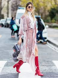 A velvet wrap dress worn over a top and skirt is a chic way to layer