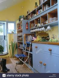 Yellow And Blue Kitchen Painted Shelves Above Pale Blue Unit In Pastel Yellow Cottage