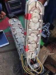 optical fiber cable investigating a fault in a fiber cable junction box the individual fiber cable strands in the junction box are visible