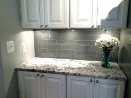 grey and white tile backsplash grey tile kitchen grey glass subway tile and white cabinet for