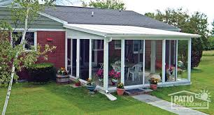 EasyRoom sunroom kit in white with a single-slope roof and solid wings