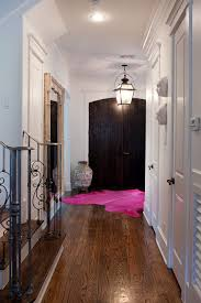 houston brown cowhide rug with synthetic area rugs entry transitional and hanging lantern