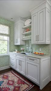 i love the contrast an oriental rug adds to a kitchen from homebunch