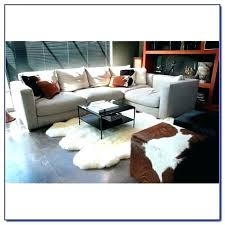 sheepskin rug brown white area rugs with cozy sofa and dresser lambskin thick sheepsk