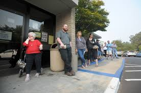 ehrlich and corey mangone of placerville wait in line at the placerville department of motor vehicles wednesday morning while the dmv opens at 9 a m