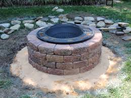 round brick home fire pit designs with cover over yard surrounding stones placementand green grass