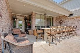Concrete patio with brick border patio rustic with outdoor kitchen