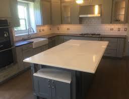 caesarstone s calacutta nuvo and piatra grey countertop on gray cabinet in naperville il