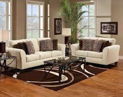 living room coffee table on brown patterned area rug on hardwood floor with glass window