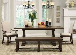 antique dark brown wood dining set with bench with twin meval pendant lighting over a wooden table