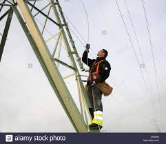 electrical power line installers and repairers dutch electrical power line repairers at work stock photo 65289815