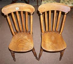 lot 491 a pair of elm high wycombe dining chairs makers mark on back