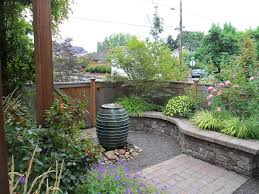 retaining walls omaha ne with traditional landscape and bubbler courtyard fence flowers gravel lush pot rocks small stone stone wall tree wall water water