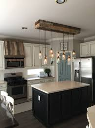 mason jar light and faux oven hood pallet wood white cupboards but some colour warm lights and rustic wood