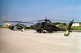 A Left Front View Of A Us Army Ah 64a Apache Helicopter Parked