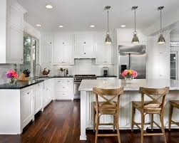 enchanting white kitchen cabinets with black countertops on