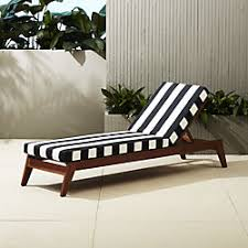 Black and white patio furniture Wrought Iron Filaki Lounger With Black And White Stripe Cushion Cb2 Unique Outdoor Furniture And Decor Cb2