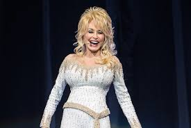 dolly parton talks to us about her uping lipstick self care and bedazzling her bra