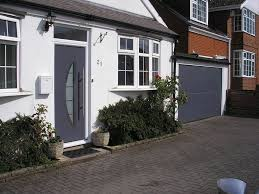 garador entrance door with a ryterna sectional garage door colour matched in anthracite grey