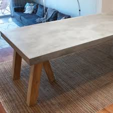 concrete and reclaimed teak dining table