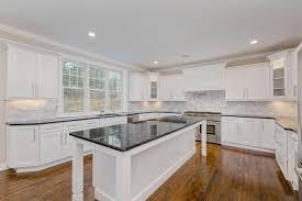 steel gray polished granite countertop eased edge white carrrara marble subway tile backsplash