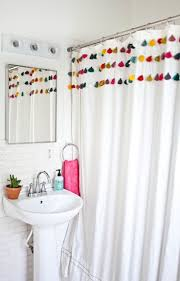 love the tassels on the basic white shower curtain