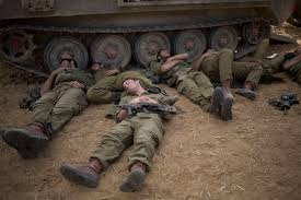 photos top images from around the world com i ier sleep beside a military vehicle near the gaza border early tuesday
