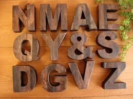 antique style wooden letter alphabet figurine a t brown sculpture roman alphabet signs