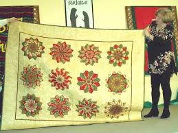 Winter-themed quilts to be displayed at gingerbread contest Dec. 9 ... & Ocean Waves Quilt Guild member Irene Chandler displays her Christmas quilt.  SUBMITTED PHOTO Adamdwight.com