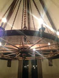 metal wagon wheel chandelier the kitchen light is an old wagon wheel chandelier suspended by chains