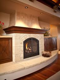 interior beige tile fireplace with beige fireplace base and black metal fire box also brown