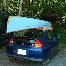 canoe on homemade wooden rack on honda insight