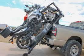 most motorcycles will load directly onto the deck either ancd with tie downs or add wheel chocks for security we recommend the condor brand chocks