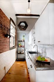 fabulous way of creating diffe visual sections in the kitchen with a brick wall design