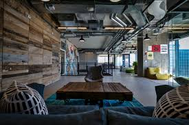 natural office lighting. the prominent social interaction atmosphere that is so identified with facebook \u2013 reflected in huge industrial flavored office space combines natural lighting t