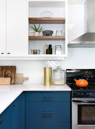 Dark Blue Kitchen Cabinets This Home Received An Updated Kitchen With Blue Cabinets And White