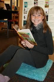 crestview fifth grader grace derouin reading saving zasha